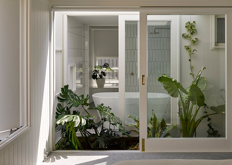 A shot of the open, light-filled bathroom of the Cantala Avenue House.