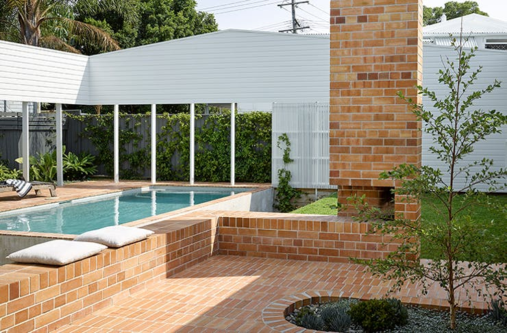 A shot of the brick courtyard and pool of the Cantala Avenue House.