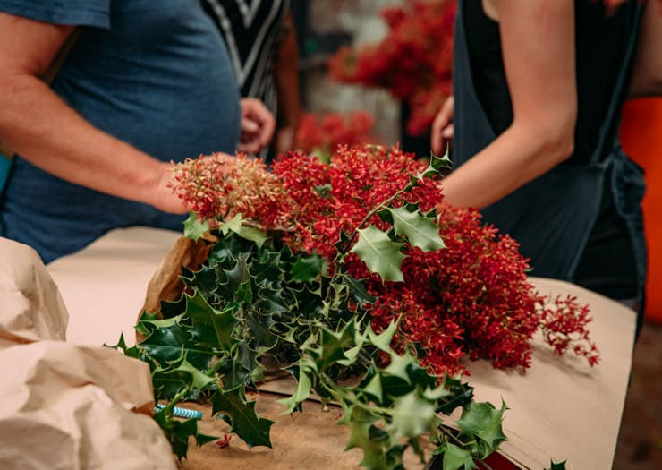 Christmas bush and holly wrapped in brown paper.