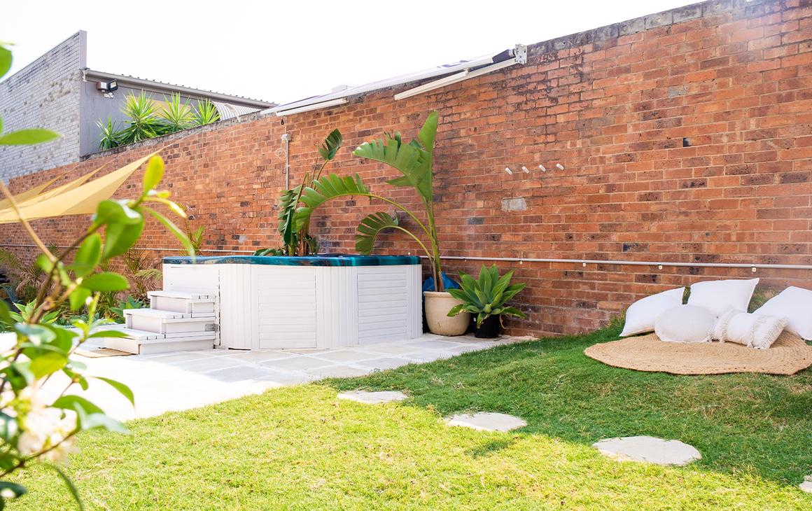 A spa in a grassy space