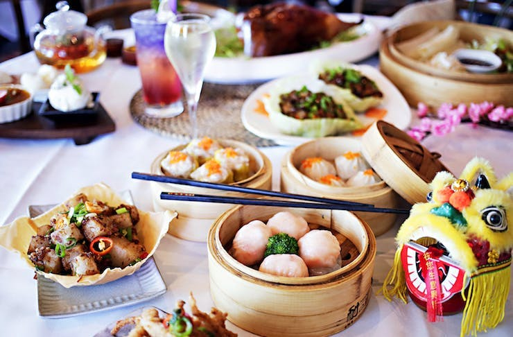 A table packed with delicious dumplings and other Chinese eats.