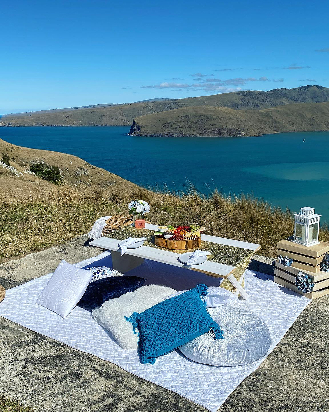 An ideal picnic set up at Godley Head by Christchurch Luxury Picnics.