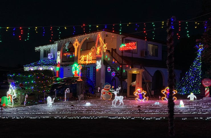 a house lit by Christmas lights