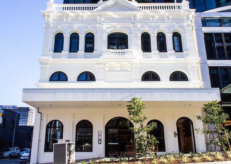 white front facade of a heritage building