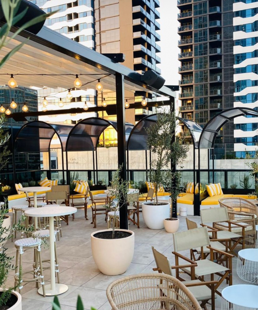 interior of Cielo's rooftop bar area, with yellow booths and euro style tables