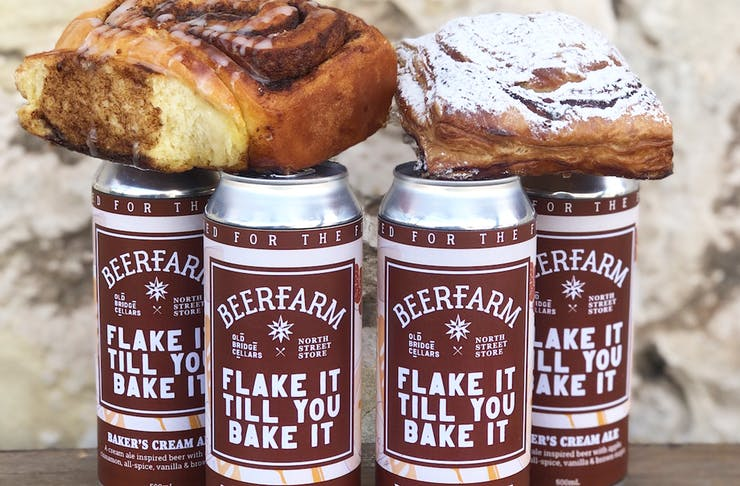 4 beer cans with cinnamon scroll and apple turnover on top