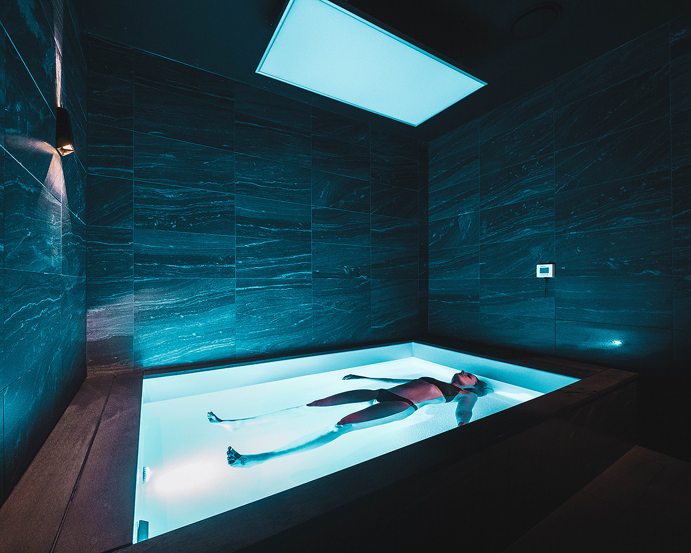 A person relaxes in a luxurious float room at City Cave.
