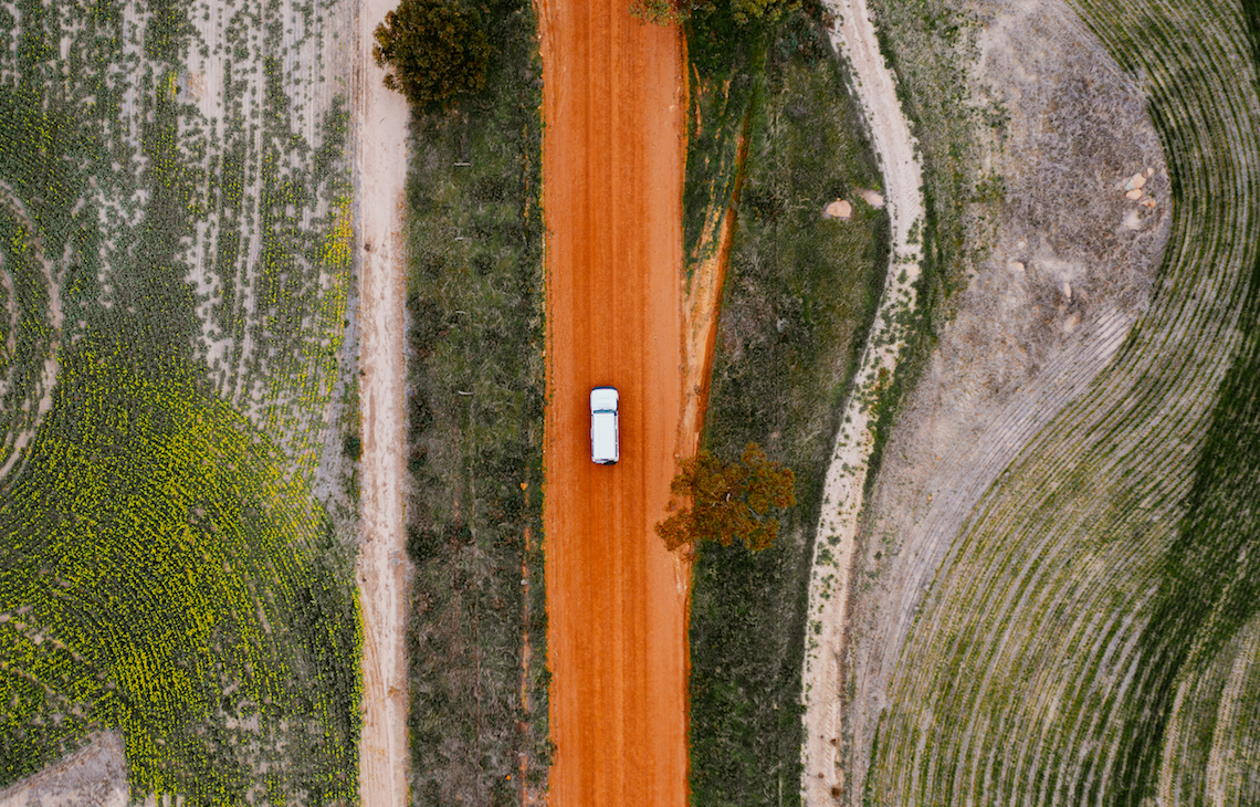Aerial view of one car driving on a great southern outback road