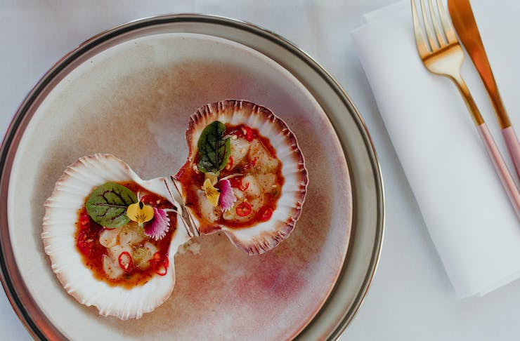 a pair of scallops on a plate