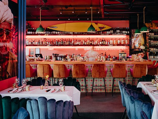 the interior of a vibrant indian restaurant in byron