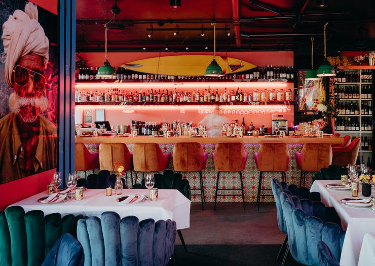 the interior of a vibrant indian restaurant