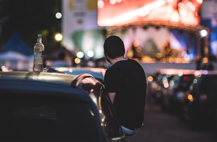 A person in a car at a drive in cinema.