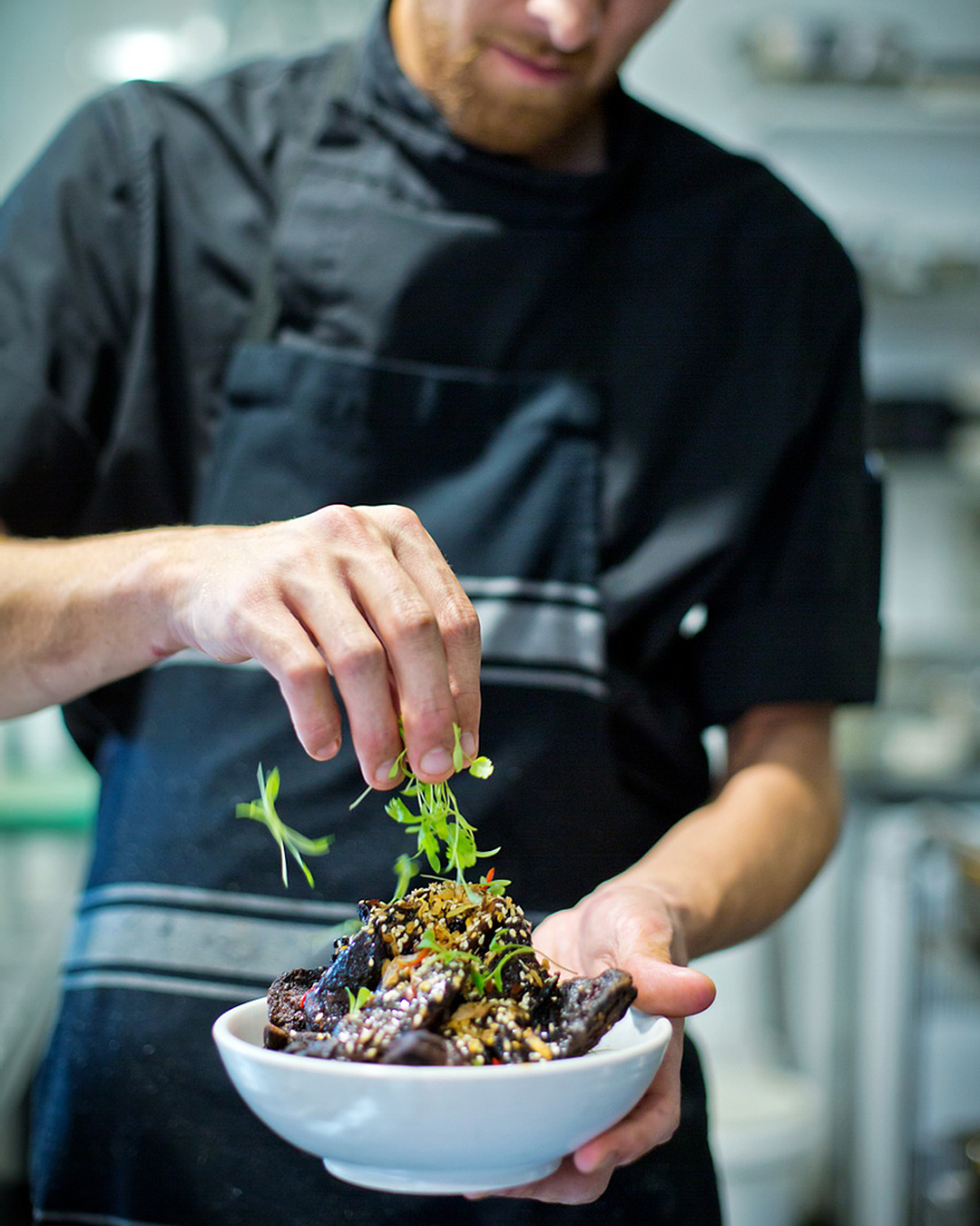 A chef preps a dish at Emerson's Brewery Restaurant in Dunedin.