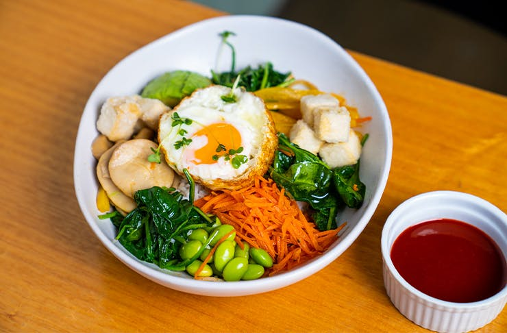 a bowl of fresh vegetables and tofu
