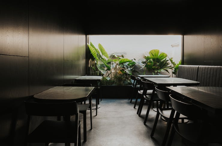 dining area with a window overlooking a garden