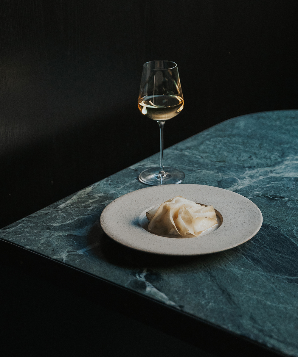 plate of kohlrabi with a glass of wine
