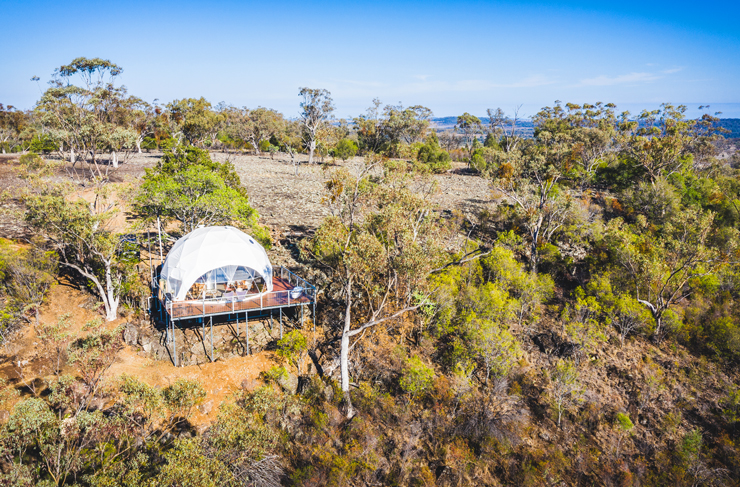 an aerial shot of a white dome tent
