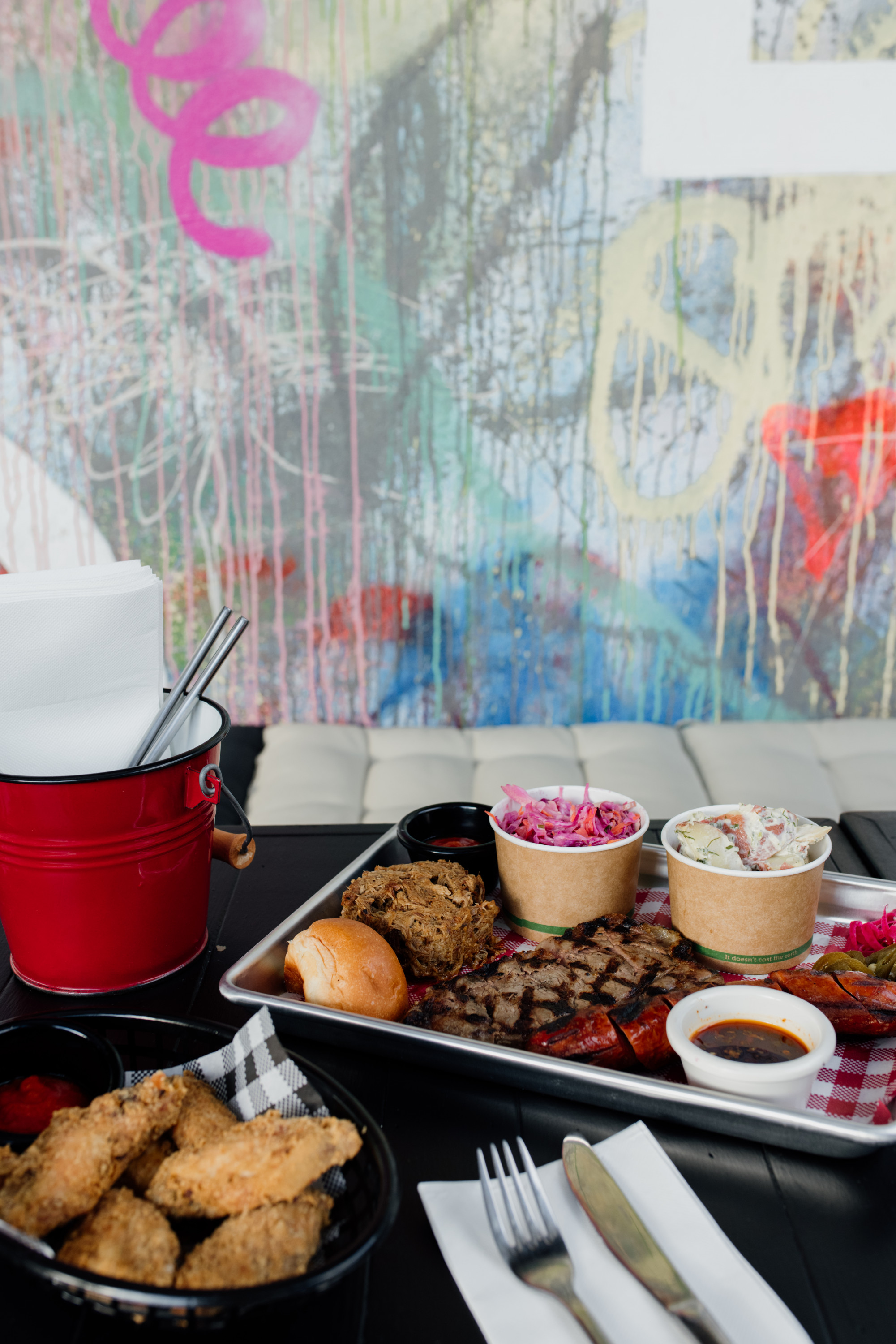 a bbq platter with graffiti in the background