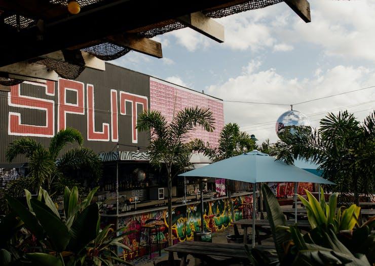 a graffitied rooftop bar