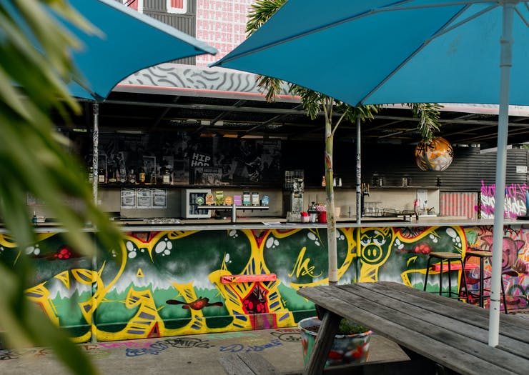 a graffitied bar on a rooftop