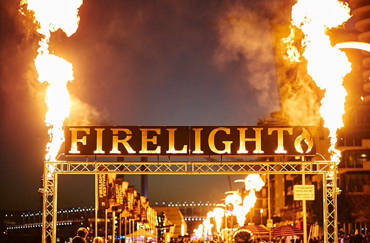 A sign that reads 'Firelight' with large flames erupting on both sides.