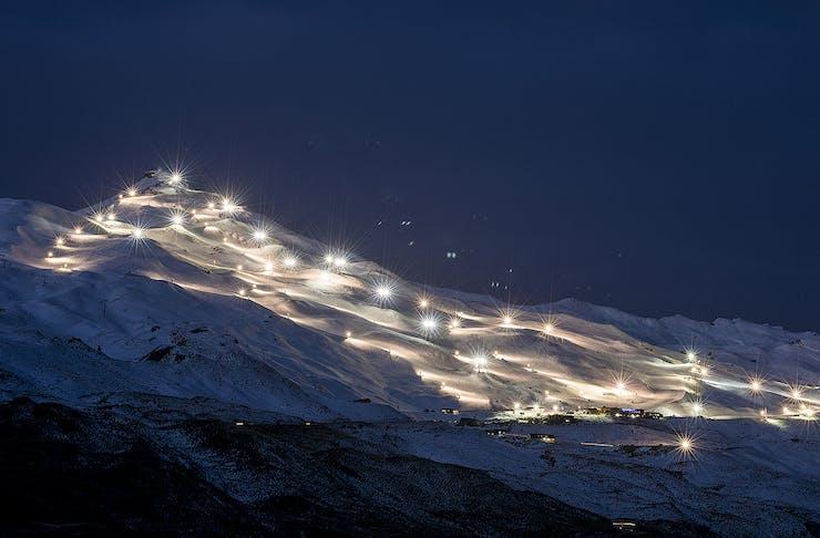 Floodlit ski slopes at Coronet Peak