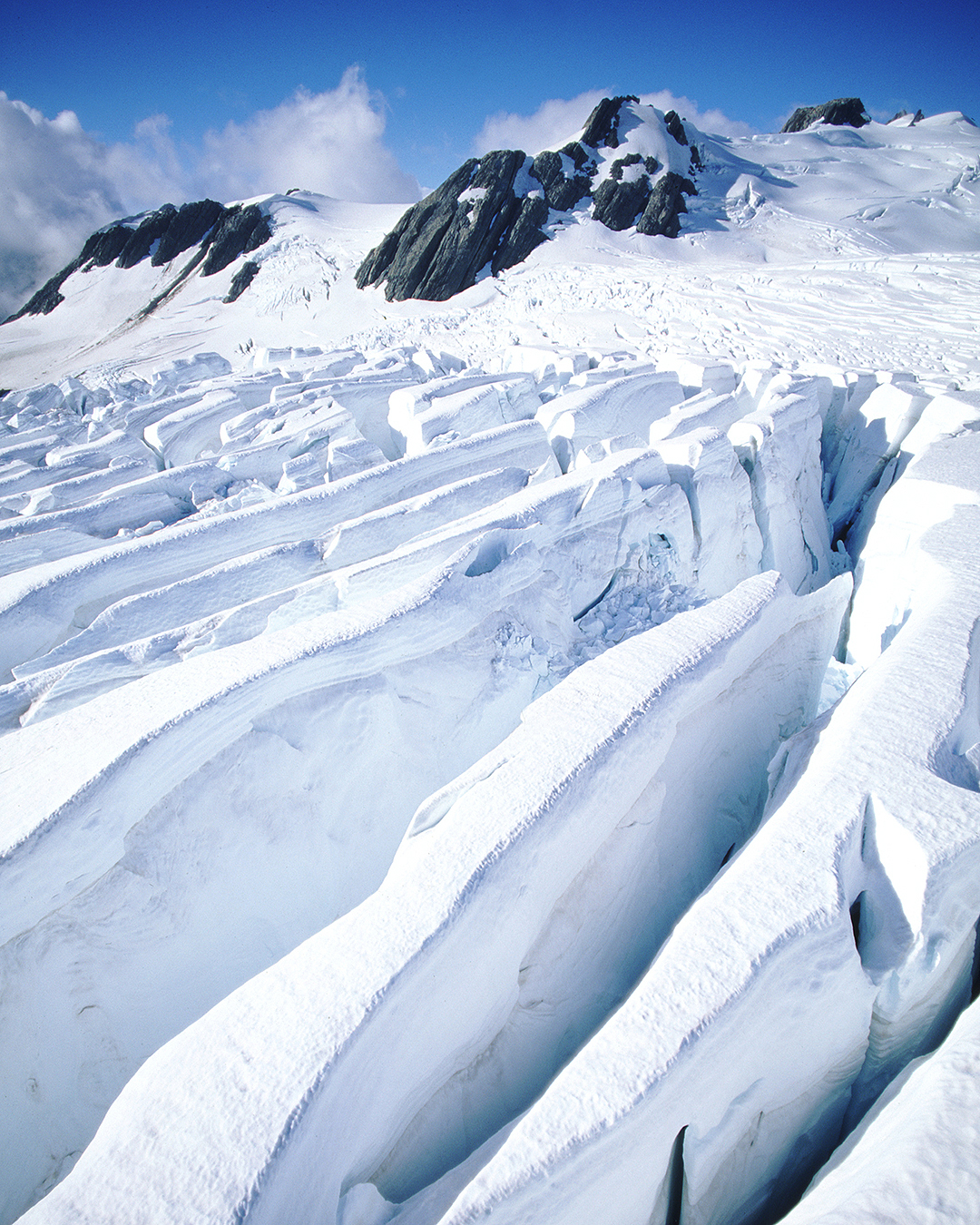 Deep snow and mountains at Franz Joseph Glacier