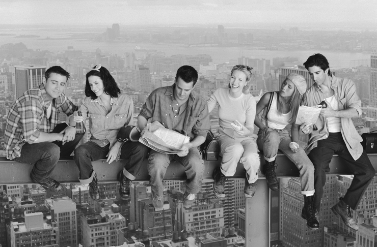 The cast of Friends sits on a steal bet strung high above New York City