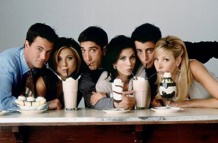 The cast of Friends drinking milk shakes and eating ice cream sundaes