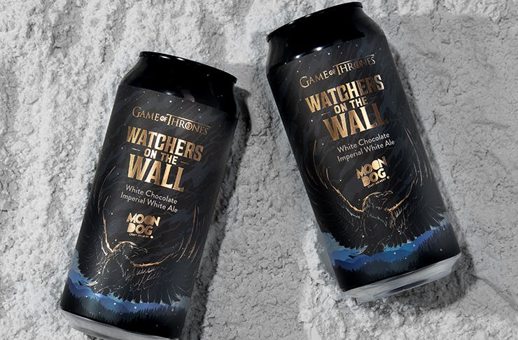 Two beer cans with Game of Thrones branding lying on a bed of snow