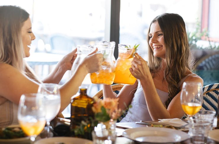 Galentine's Day Perth 2021, girls clinking cocktail jugs together