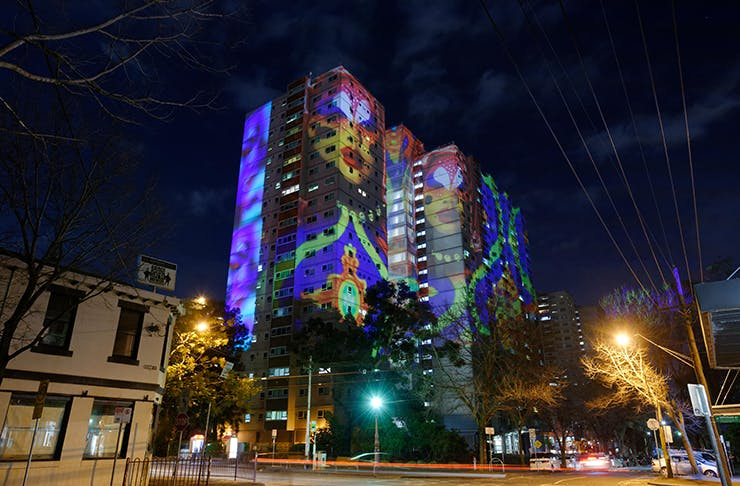 A large building in Fitzroy lit up with projection for the Gertrude Street Projection Festival.