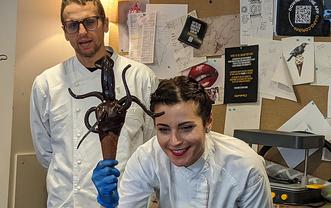 Giapo and Annarosa of Giapo hold out their famous colossal squid.