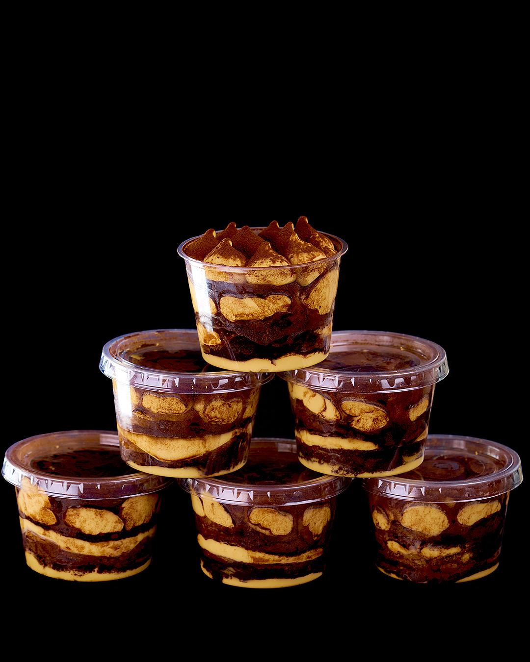 The delicious Giapo tiramisu stacked on a black background.