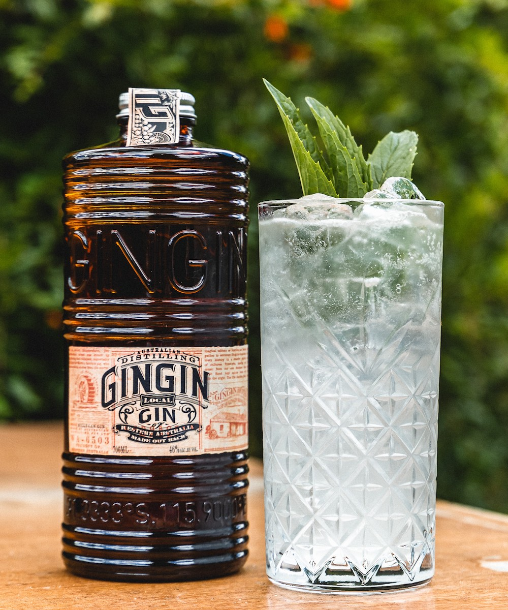 Bottle of Gingin Gin next to tall glass
