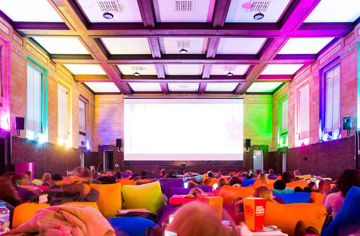 inside Girls School Cinema with bright bean bags
