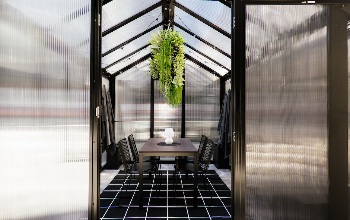 The inside of the glasshouse dining pods