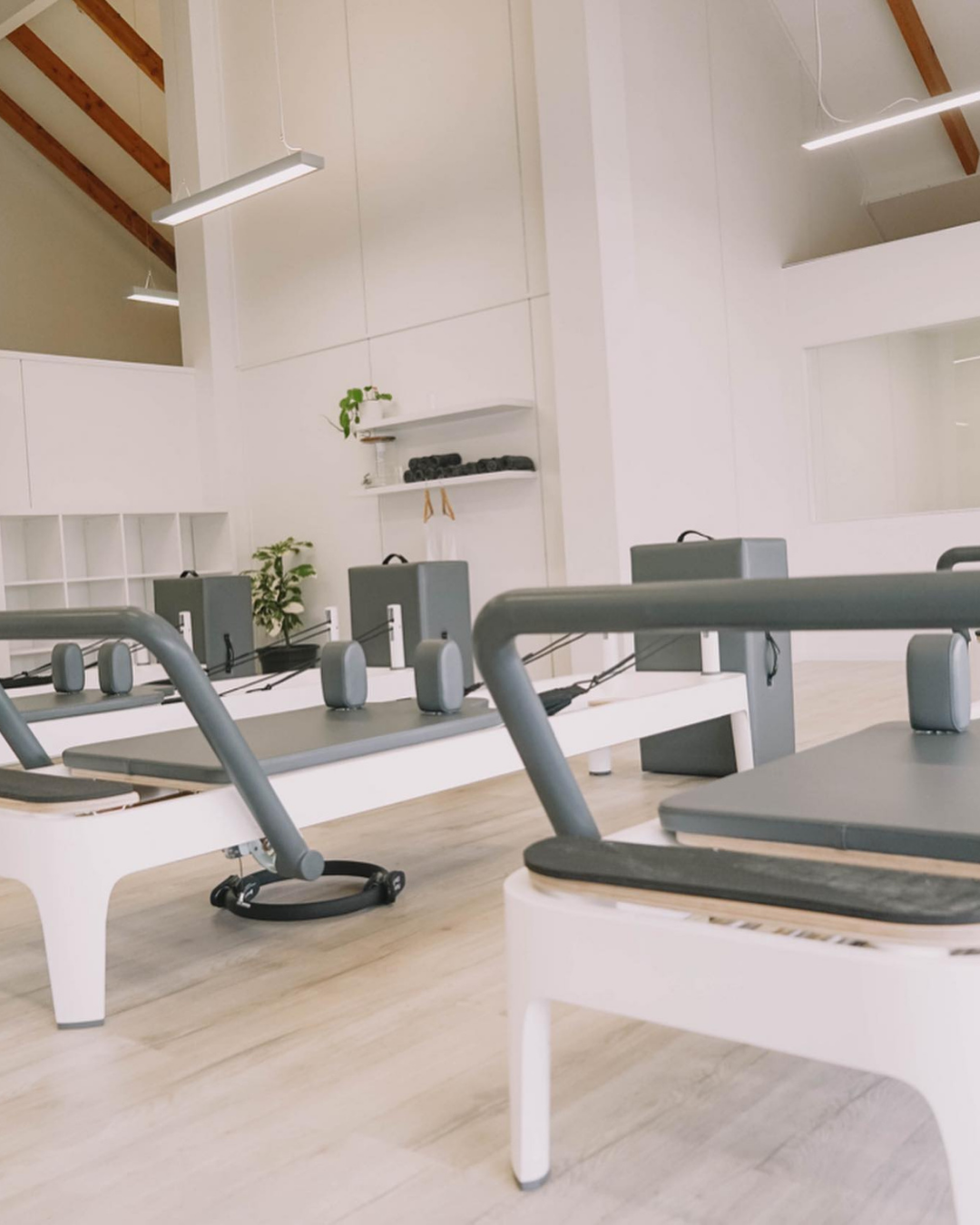 An empty gym with Pilates equipment