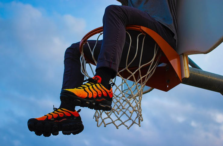 Guy wearing cool sneakers on basketball court