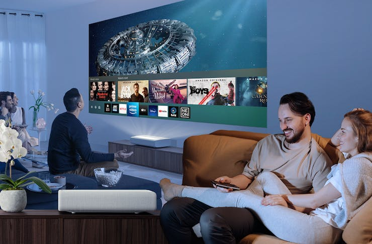 A Collage of friends enjoying a movie night, a couple and Samsung's The Premiere 4K Laser Projector