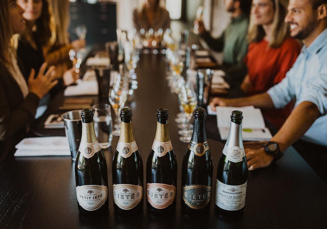 Five bottles of sparkling lined up for tasting
