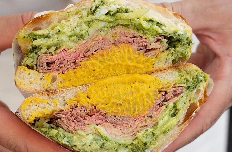 A photo of a Hector's Deli South Melbourne sandwich with mustard and roast beef