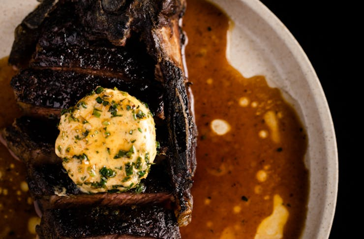 Close up image of organic grass fed beef with smoked garlic butter at Heritage Wine Bar