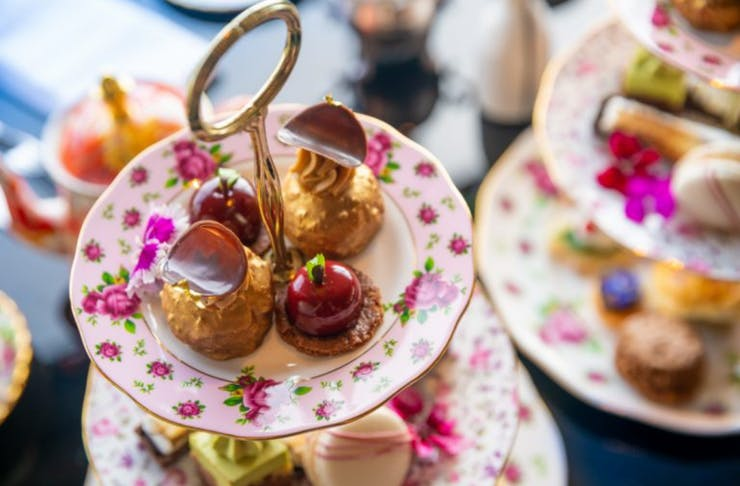 A beautiful selection of savoury and sweets on a high tea tray