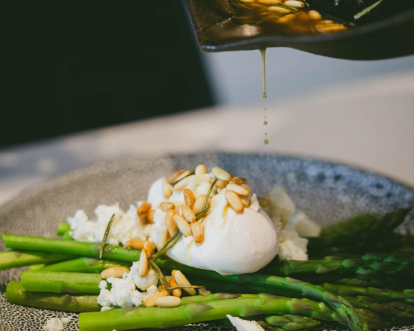 An egg, asparagus and pine nut dish at Homeland.