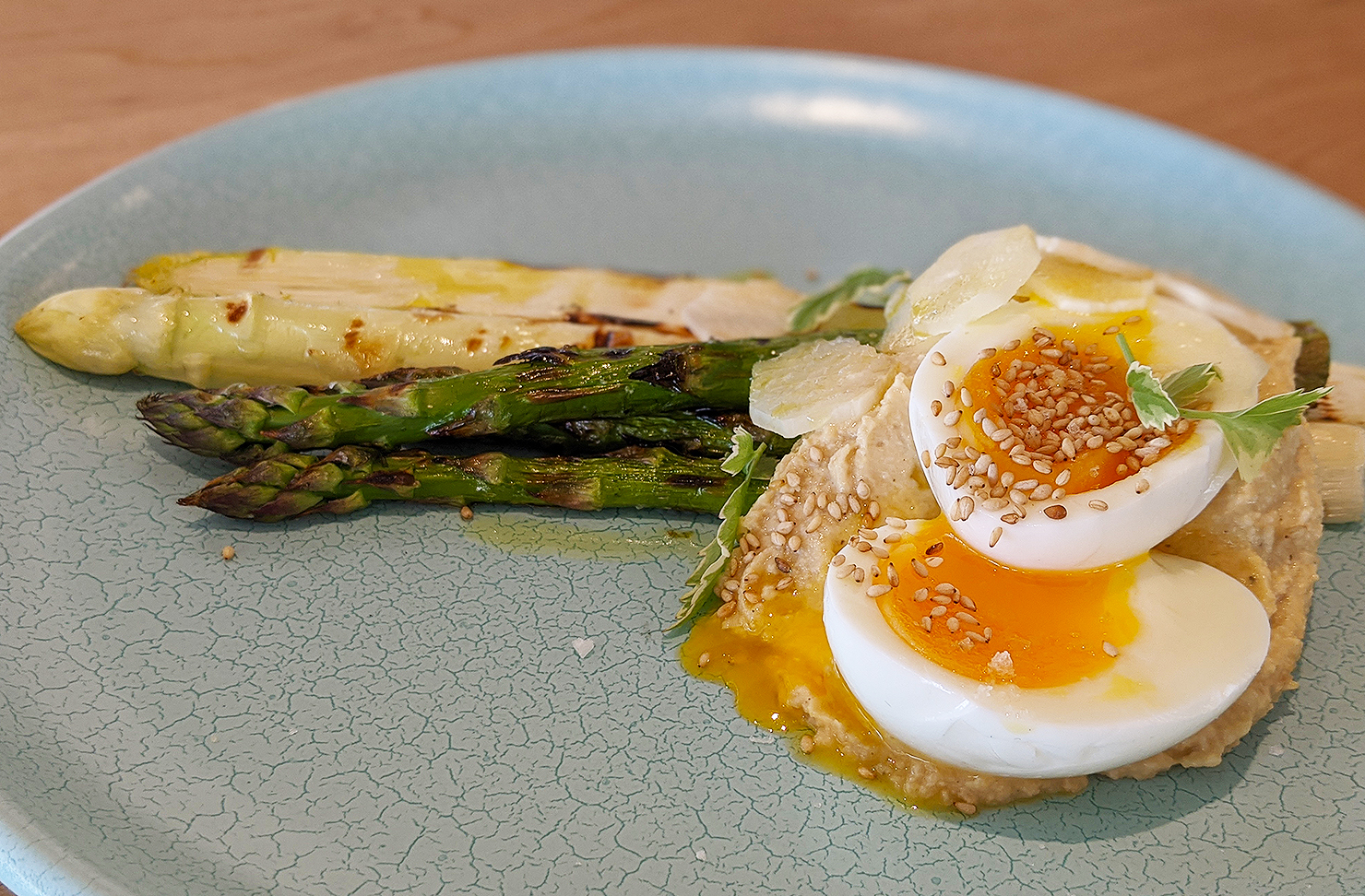 Asparagus with soft boiled eggs with hummus.