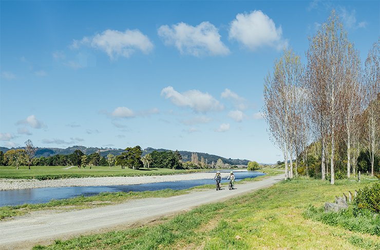 The Hutt River Trail with two people cycling in pure idyllic weather.