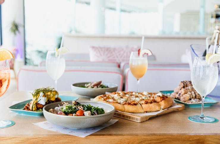a table with food and cocktails