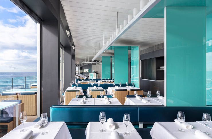 The dining room at Sydney restaurant Icebergs, with its view out across Bondi Beach.