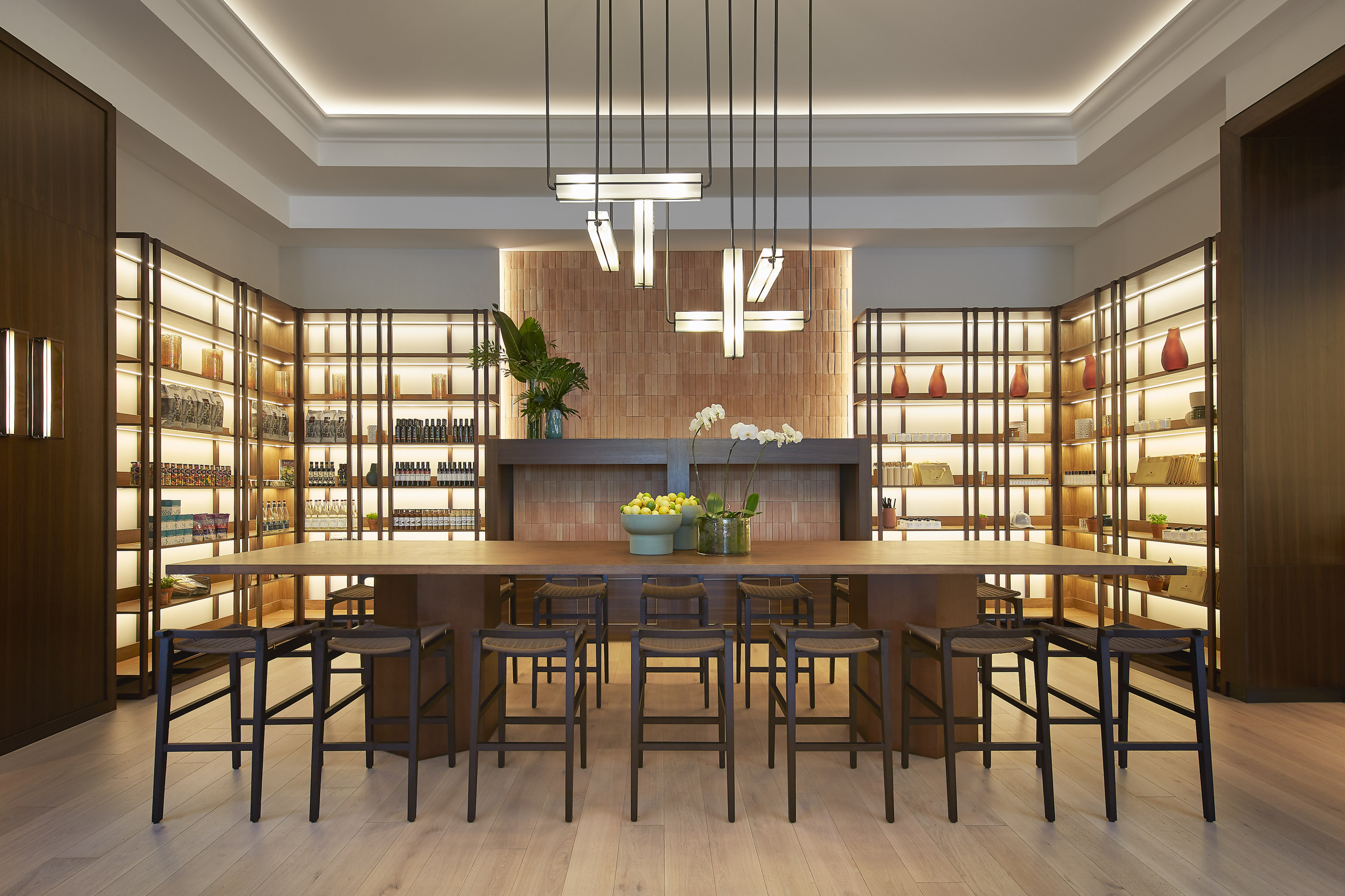 a dining room with illuminated shelves